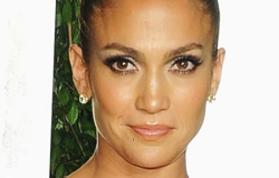 Jennifer Lopez in a top knot hairstyle at the 2012 Vanity Fair Oscar Party.