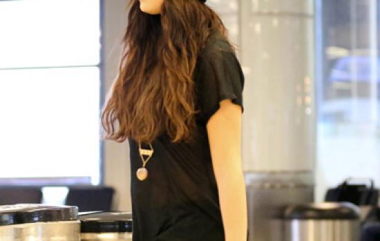 Selena Gomez at an airport in leopard print pants